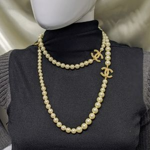 Chanel long gold pearl necklace